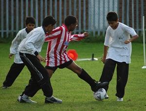 Asian playing football
