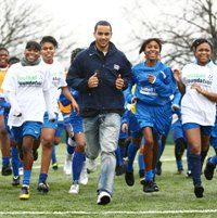 Theo Walcott with the girls of St Thomas More