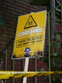 A Club Website 'condemned' sign and tape