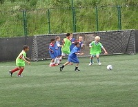 Kids in action at a Football Football session